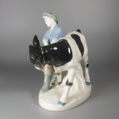 Carl Scheidig Porcelain Figurine - Young Man Pulling Young Bull Cow