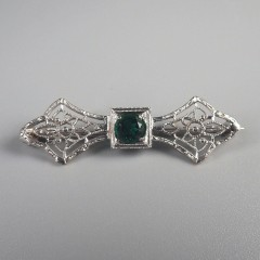 10k Filigree Bow Shaped Vintage Pin with Green Paste Simulated Emerald